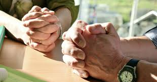 Hands praying together